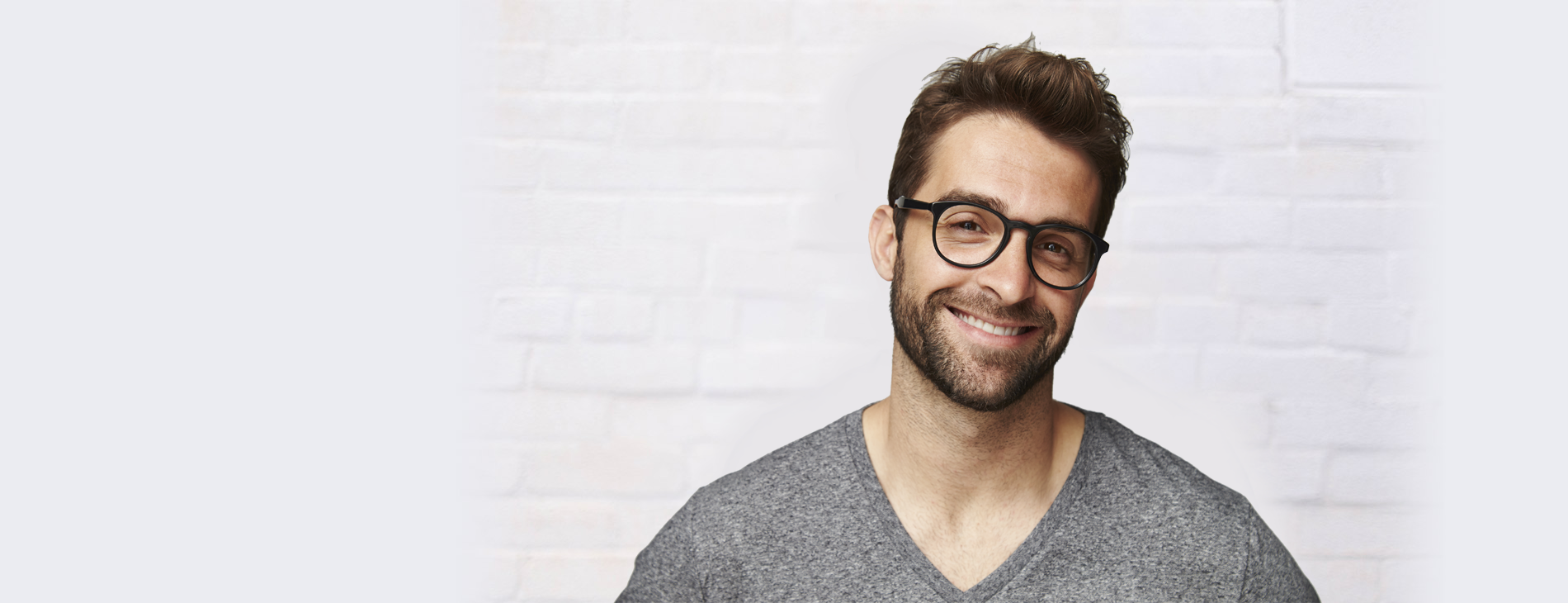 A man smiling and ready embrace the next generation of CRM with one of our tailored solutions